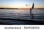 windsurfer sailing in the lake... | Shutterstock . vector #504938503