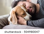 Stock photo  young man sleeping with a dog 504980047