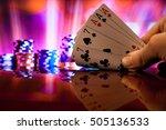 Hand Holding Full House Poker...