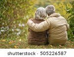 elderly couple sitting with his ... | Shutterstock . vector #505226587