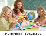teacher with two girls at... | Shutterstock . vector #505226593