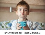 little boy sitting on a bed and ... | Shutterstock . vector #505250563