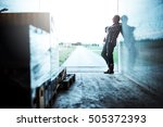 Small photo of Senior truck driver standing with crossed arms.