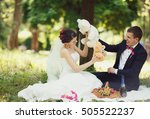 smiling couple fiddling stuffed ... | Shutterstock . vector #505522237