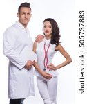 Small photo of Guy and girl in medical garb and with documents in hands on a white background