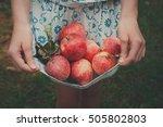 Girl Holds Apples In Hemline....