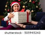 happy little girl holding gift... | Shutterstock . vector #505945243