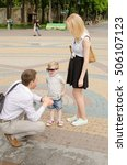 young family is walking in the... | Shutterstock . vector #506107123