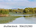 A Small Boat Floats Through Th...