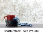 red mug wrapped a woolen scarf... | Shutterstock . vector #506196283