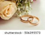 wedding rings lie on a... | Shutterstock . vector #506395573
