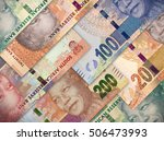 Small photo of Different money bills stacked over each other forming a money background.