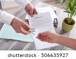 estate agent giving house keys...   Shutterstock . vector #506635927