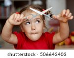 cute little girl cutting hair... | Shutterstock . vector #506643403