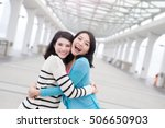 two beauty woman hug together in hongkong
