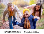 family playing catch up on a... | Shutterstock . vector #506686867