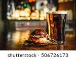 hamburger and dark light beer...   Shutterstock . vector #506726173