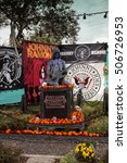 Small photo of Los Angeles, CA, USA - October 29, 2016: Flower and skeleton alter for Johnny Ramone at Dia de los Muertos, Day of the dead, in Los Angeles at the Hollywood Forever Cemetery grounds. Editorial