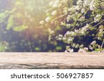 wood table top and blurred... | Shutterstock . vector #506927857
