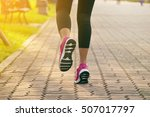 sporty woman running on road at ... | Shutterstock . vector #507017797