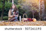 young woman sitting on picnic... | Shutterstock . vector #507261193