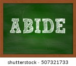 Small photo of ABIDE handwritten text on green chalkboard