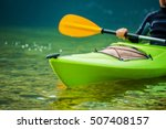 Caucasian Kayaker On The River...