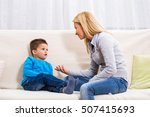 mother and son sitting on sofa... | Shutterstock . vector #507415693