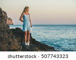 Young Blond Tourist Woman In...