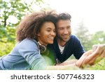 mixed raced couple laying in... | Shutterstock . vector #507746323