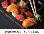 sashimi and sushi rolls on a... | Shutterstock . vector #507781507