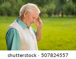 senior man touches his forehead.... | Shutterstock . vector #507824557