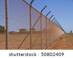A Long Nasty Fence In The Red...