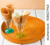 Small photo of Waffle cones with italian pistachio and vanilla gelato ice cream . selective focus.