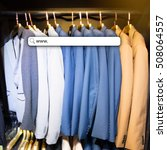 Small photo of Blur of suit in hang in store and bokeh light with address bar, online shopping background, business, E-commerce