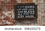 "Small photo of Wooden Framed Wall Sign. Sign says, ""In Our Home Let Love Abide And Bless All Those Who Step Inside"""