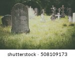 Tombstone and graves in an...
