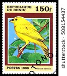 Small photo of STAVROPOL, RUSSIA - October 31, 2016: A stamp printed by Benin shows bird an Sicalis Flaveola, circa 1999