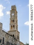 Small photo of old clock tower, Han El-Umdan, Acre, Israel