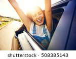 woman leans out car window and... | Shutterstock . vector #508385143