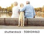 Stock photo senior couple sitting back on bund 508434463