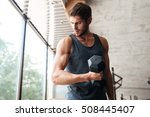 fitness man with dumbbell in... | Shutterstock . vector #508445407