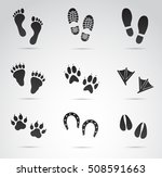 Stock vector human and animal footprints icon set on white background vector art 508591663