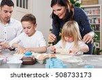 family bakes christmas cookies | Shutterstock . vector #508733173