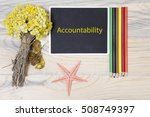 Small photo of sentence Accountability, written with chalkboard with pen, starfish, and flower