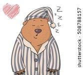 cute sleepy bear in a pajama...