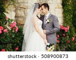 groom and bride in the garden | Shutterstock . vector #508900873