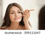 beautiful girl applying... | Shutterstock . vector #509111047