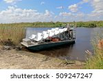 Small photo of Empty airboat waiting for passengers for an ecotour of the Florida Everglades.
