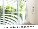venetian blinds by the window | Shutterstock . vector #509302693